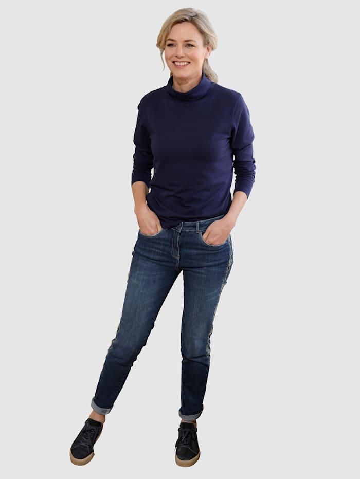 Jeans met luxueus borduursel langs de zijnaad