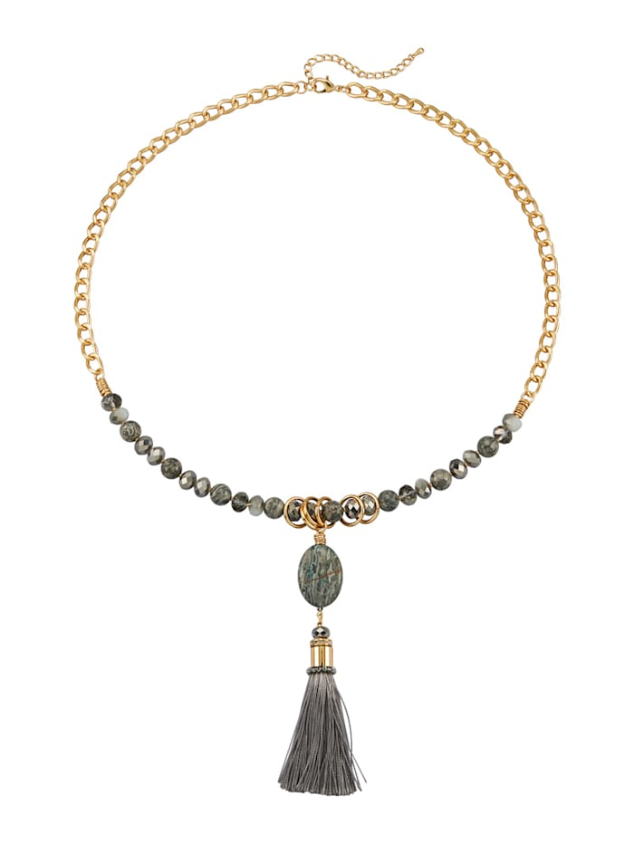 Halsband med charmig tofs