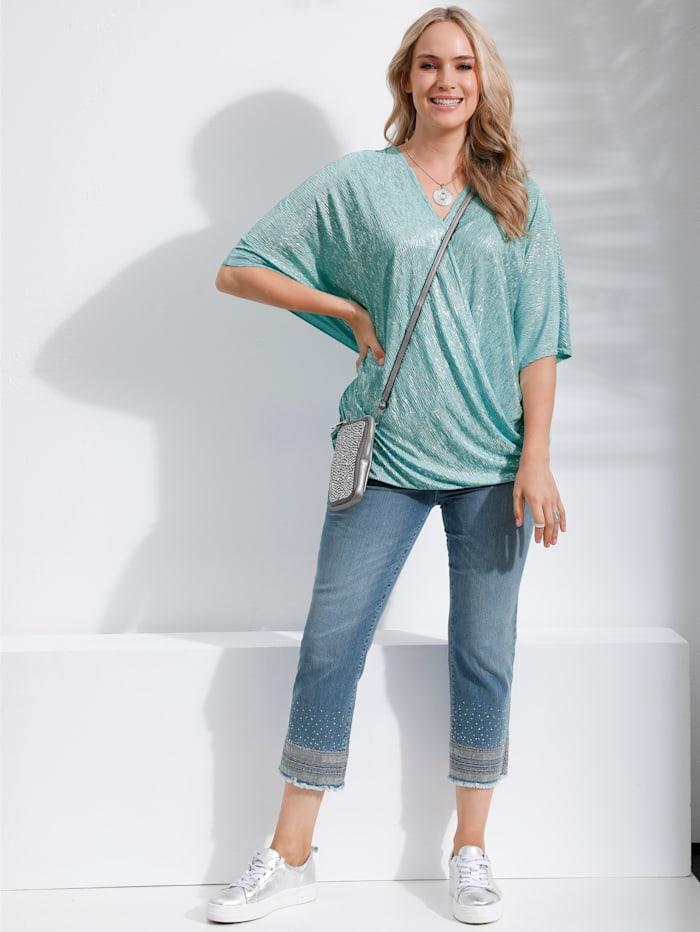 Džínsy s výšivkou, strapcami a flitrami