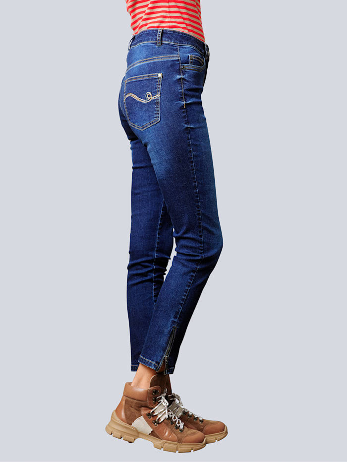 Jeans med strass på baklommene