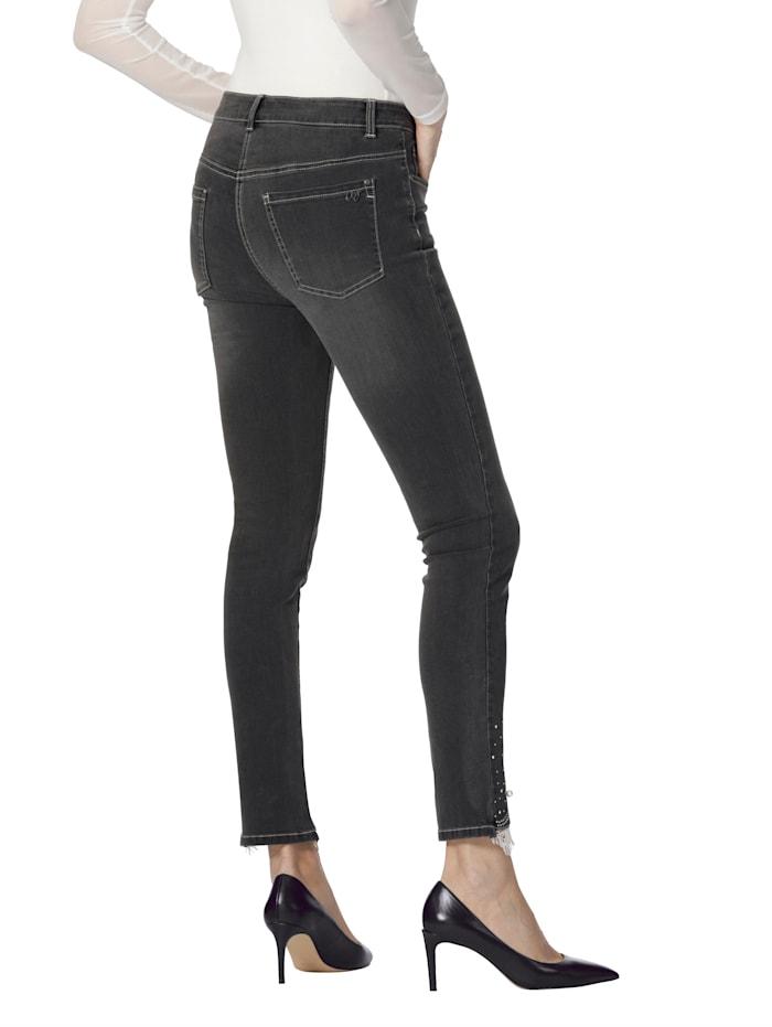 Jeans mit Spitze und Strasssteindekoration