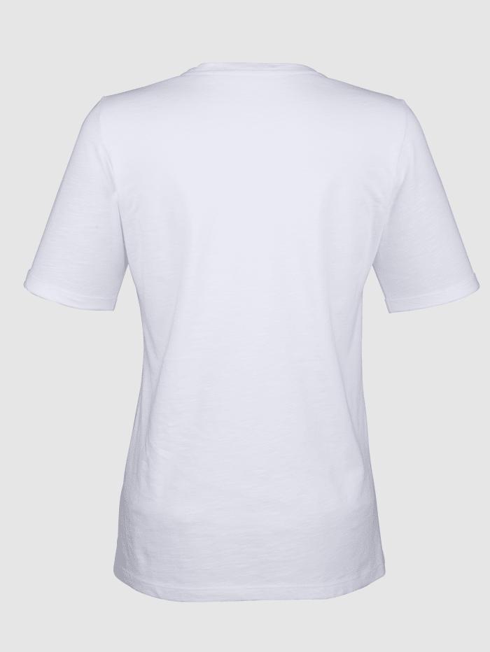Paljettisomisteinen paita
