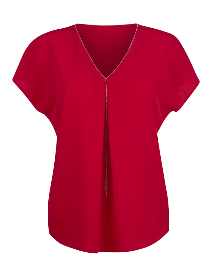 Bluse mit filigranem Kettendetail am Ausschnitt