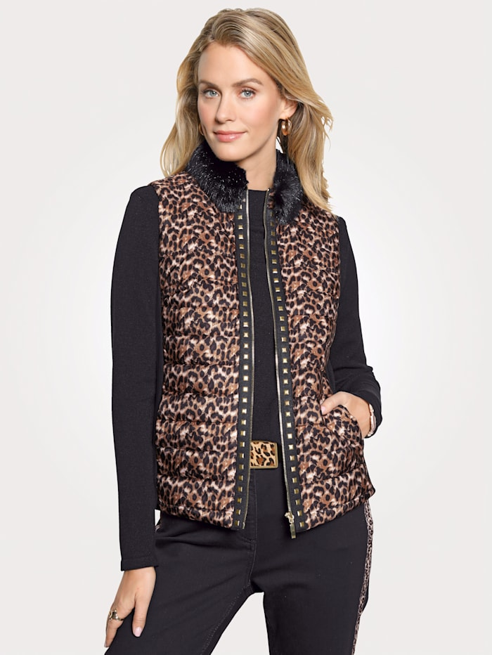 Quilted gilet with a faux fur trim