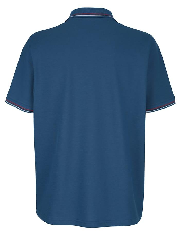 Poloskjorte med trykk på venstre bryst