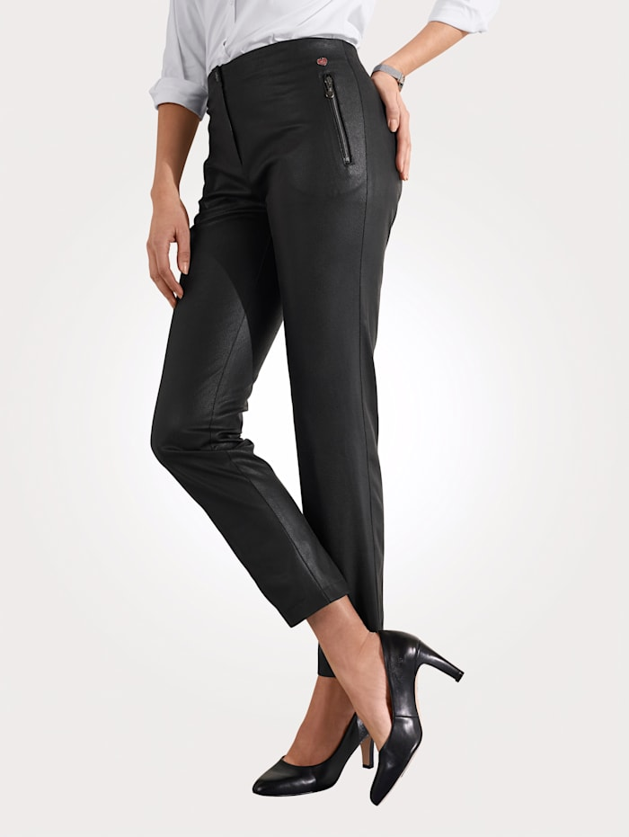 Trousers made from embossed faux leather