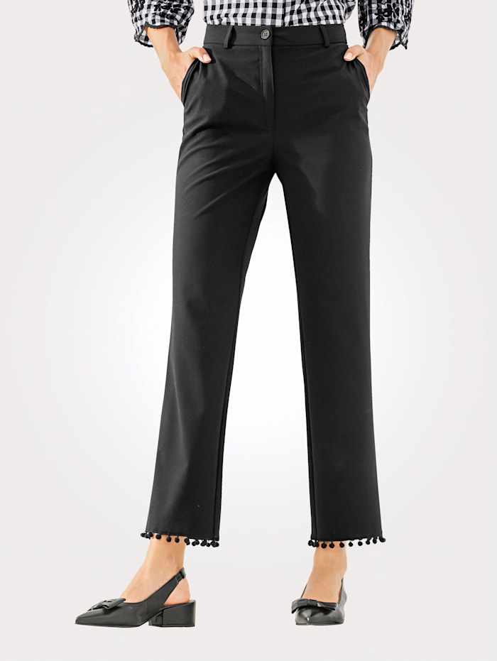 Trousers with decorative pom-poms