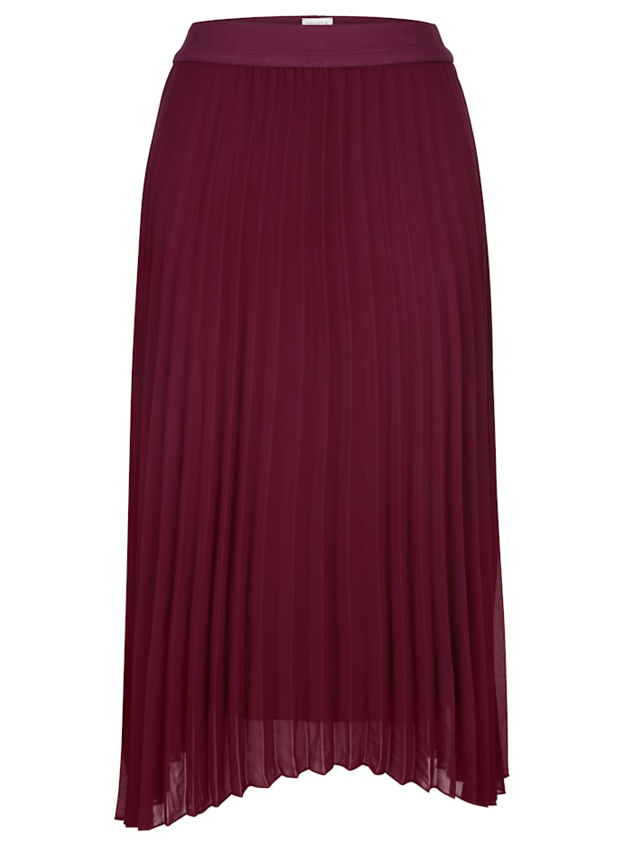 Pleated skirt made from a draping fabric