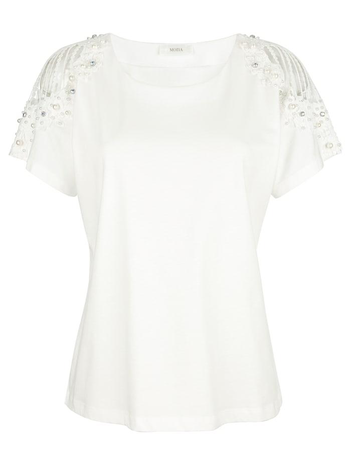 Shirt met cut-outs en versiering