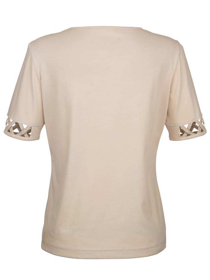 Leikkauksillasomistettu paita