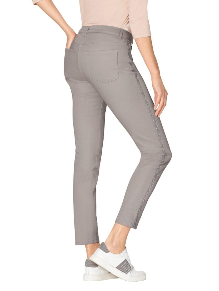 Jeans med strassrevärer
