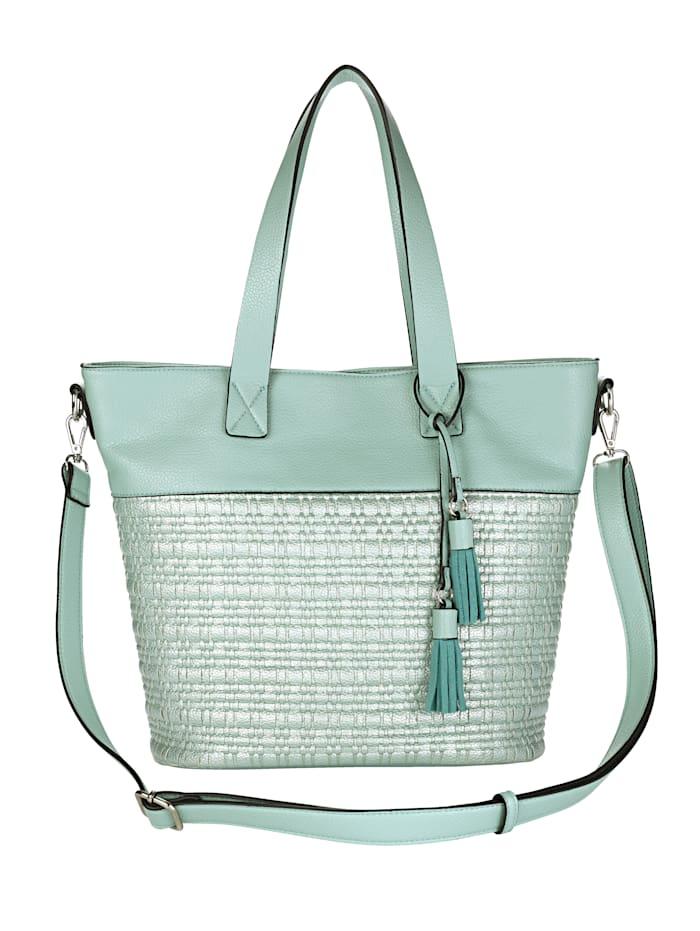 Väska med dekorativa tofsar