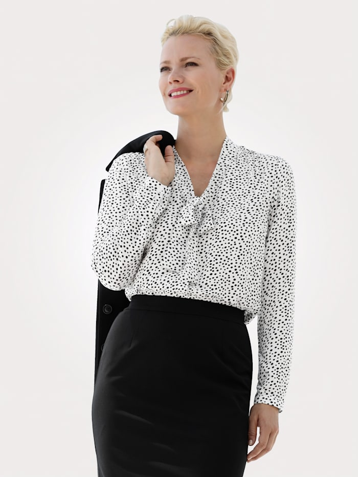 Tie neck blouse made from a soft, flowing fabric