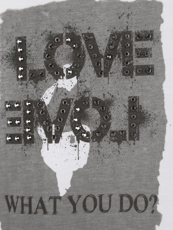 Shirt mit verschiedenen Motiven und Dekosteinen im Vorderteil
