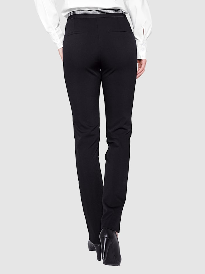 Trousers with a partially elasticated waistband