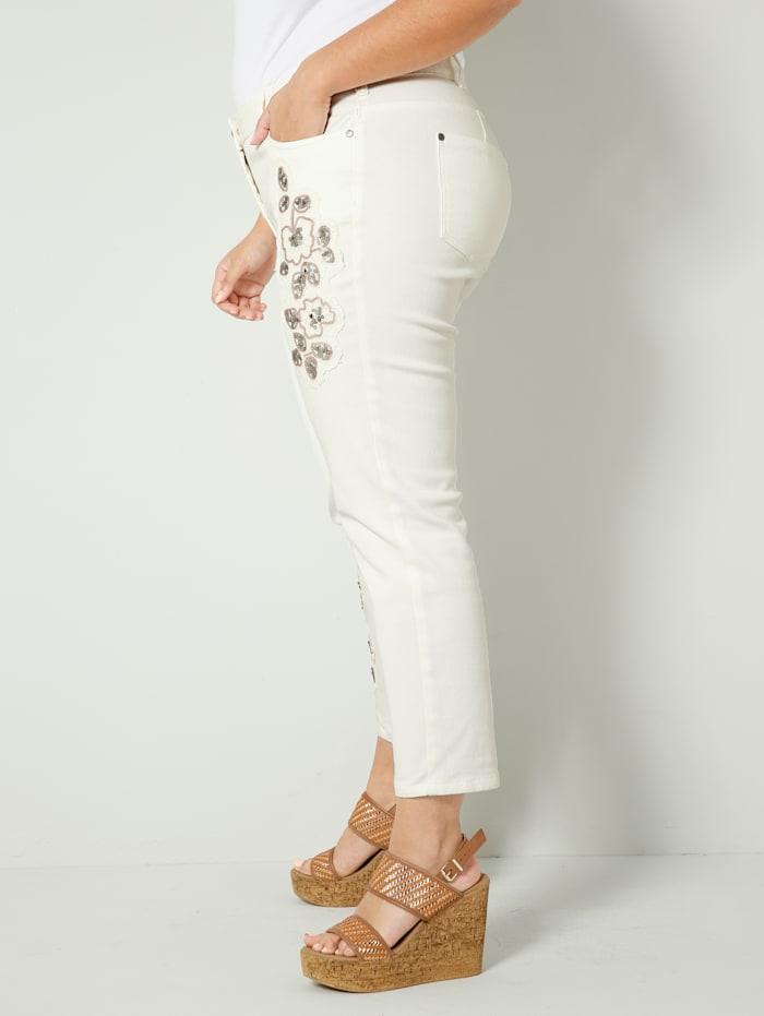 Jeans med blommiga applikationer
