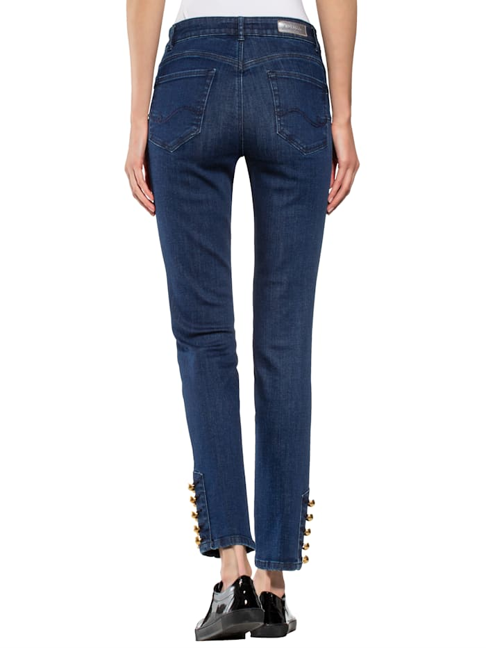 Jeans met fraaie versiering aan de pijpzomen