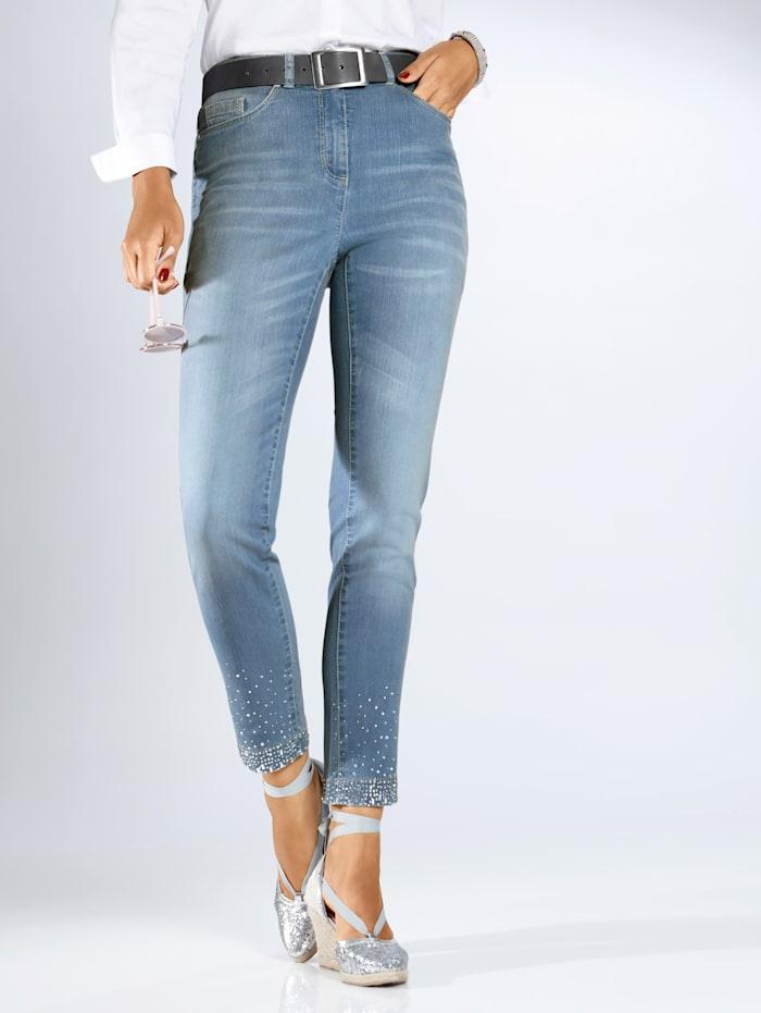 Jeans met sierstenen aan de zoom