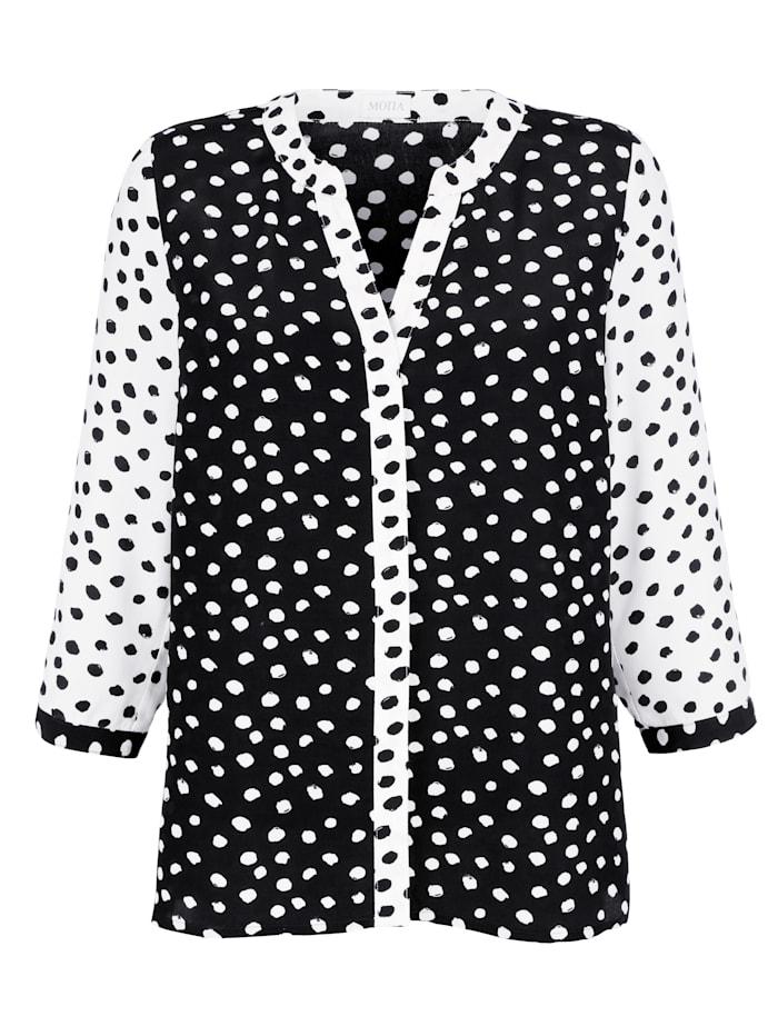Bluse mit Tupfen-Dessin in schwarz und weiß