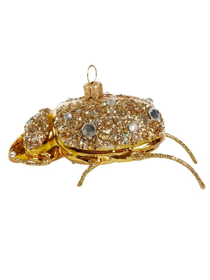 Käfer mit Steinen besetzt